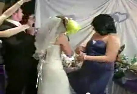 bride-burns-flowers