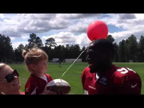 Little Girl Meets Her Football Hero