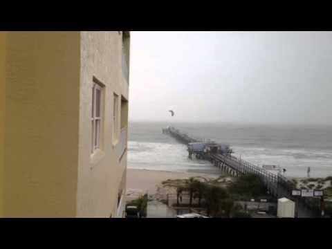 Kite Surfer Flies Over A Pier
