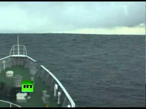 Ship Climbs Into Tsunami Waves