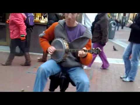 Man Plays Guitar With His Feet