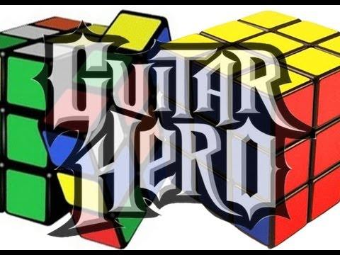Solving 2 Rubik's Cubes While Playing Guitar Hero