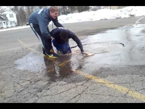 Kid Jumps Into A Puddle