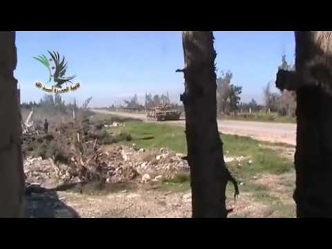 Free Syrian Army Fighter Throws A Grenade Down A Tank Barrel