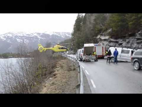 Helicopter Balances On Guardrail At Accident