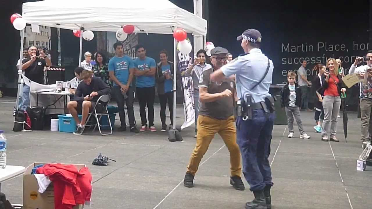 Awesome Australian Policewoman Gets Down With Street Performer