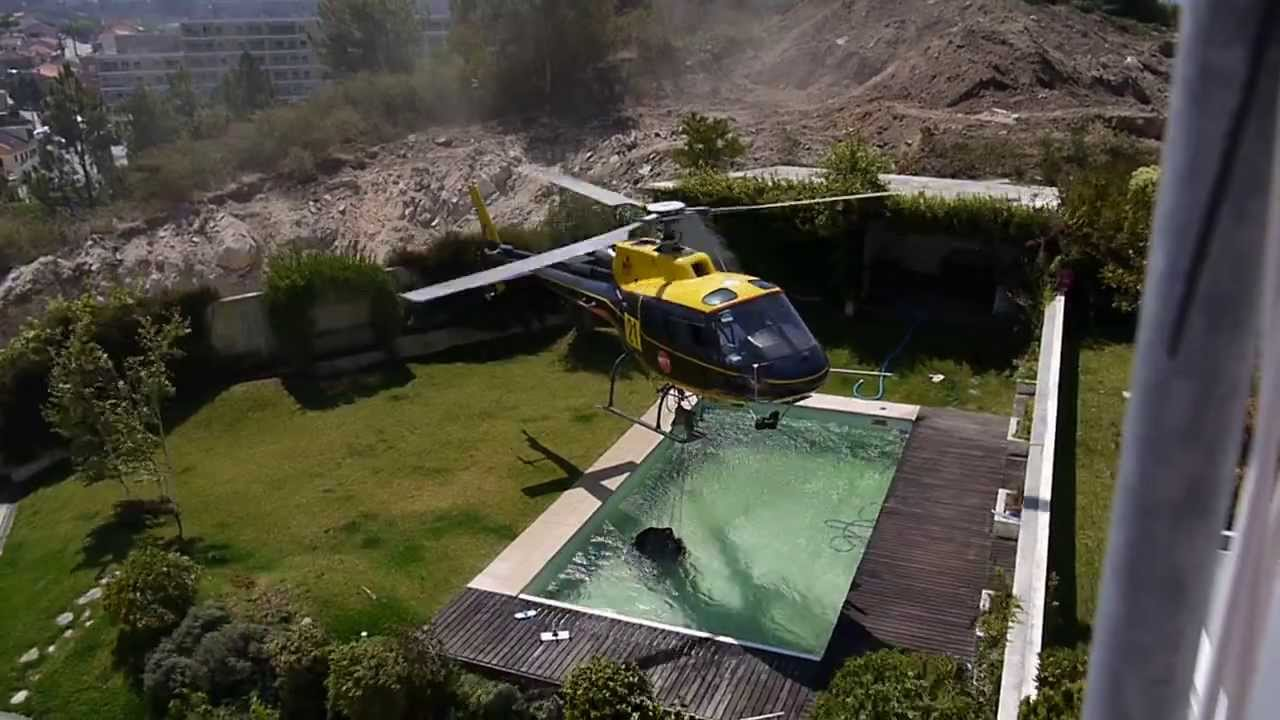 Helicopter Pilot Takes Water From A Swimming Pool