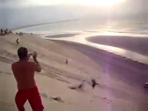 Ridiculous Backflips Down A Beach Hill