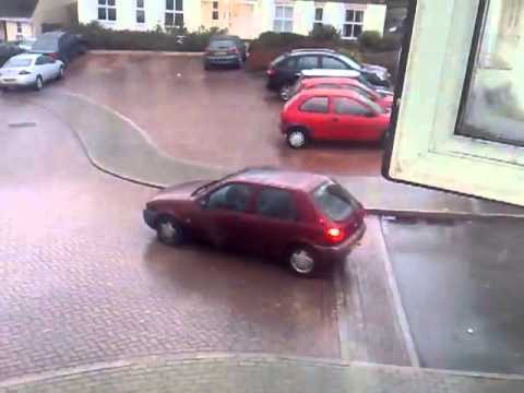 Watch These Drivers Hop Out Of A Moving Car Skidding On Ice